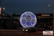 Volumetric illuminated street decoration structure